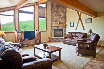 Spacious living room with gas fireplace and a view